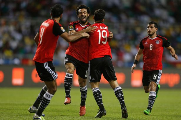 Egypts-Mohamed-Salah-celebrates-scoring-their-first-goal-with-team-mates