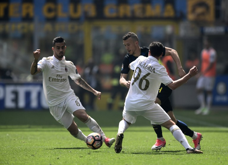 """Inter Milan's Croatian forward Ivan Perisic vies with AC Milan's Italian defender Davide Calabria (R) during the Italian Serie A football match Inter Milan vs AC Milan at the San Siro stadium in Milan on April 15, 2017. / AFP PHOTO / MIGUEL MEDINA / """"The erroneous mention[s] appearing in the metadata of this photo by MIGUEL MEDINA has been modified in AFP systems in the following manner: [Italian defender Davide Calabria] instead of [Andrea Poli]. Please immediately remove the erroneous mention[s] from all your online services and delete it (them) from your servers. If you have been authorized by AFP to distribute it (them) to third parties, please ensure that the same actions are carried out by them. Failure to promptly comply with these instructions will entail liability on your part for any continued or post notification usage. Therefore we thank you very much for all your attention and prompt action. We are sorry for the inconvenience this notification may cause and remain at your disposal for any further information you may require."""""""