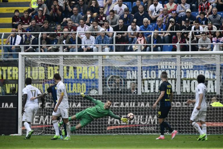 "AC Milan's Colombian defender Cristian Zapata (L) scores during the Italian Serie A football match Inter Milan vs AC Milan at ""San Siro"" Stadium in Milan on April 15, 2017. / AFP PHOTO / MIGUEL MEDINA"