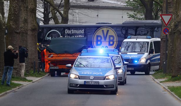 The-Dortmund-team-bus-arrives-with-a-Police-escort-before-the-match