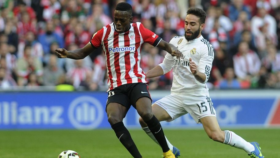 Athletic Bilbao's forward Inaki Williams (L) vies with Real Madrid's defender Daniel Carvajal during the Spanish league football match Athletic Club Bilbao vs Real Madrid CF at the San Mames stadium in Bilbao on March 7, 2015.   AFP PHOTO/ ANDER GILLENEA        (Photo credit should read ANDER GILLENEA/AFP/Getty Images)