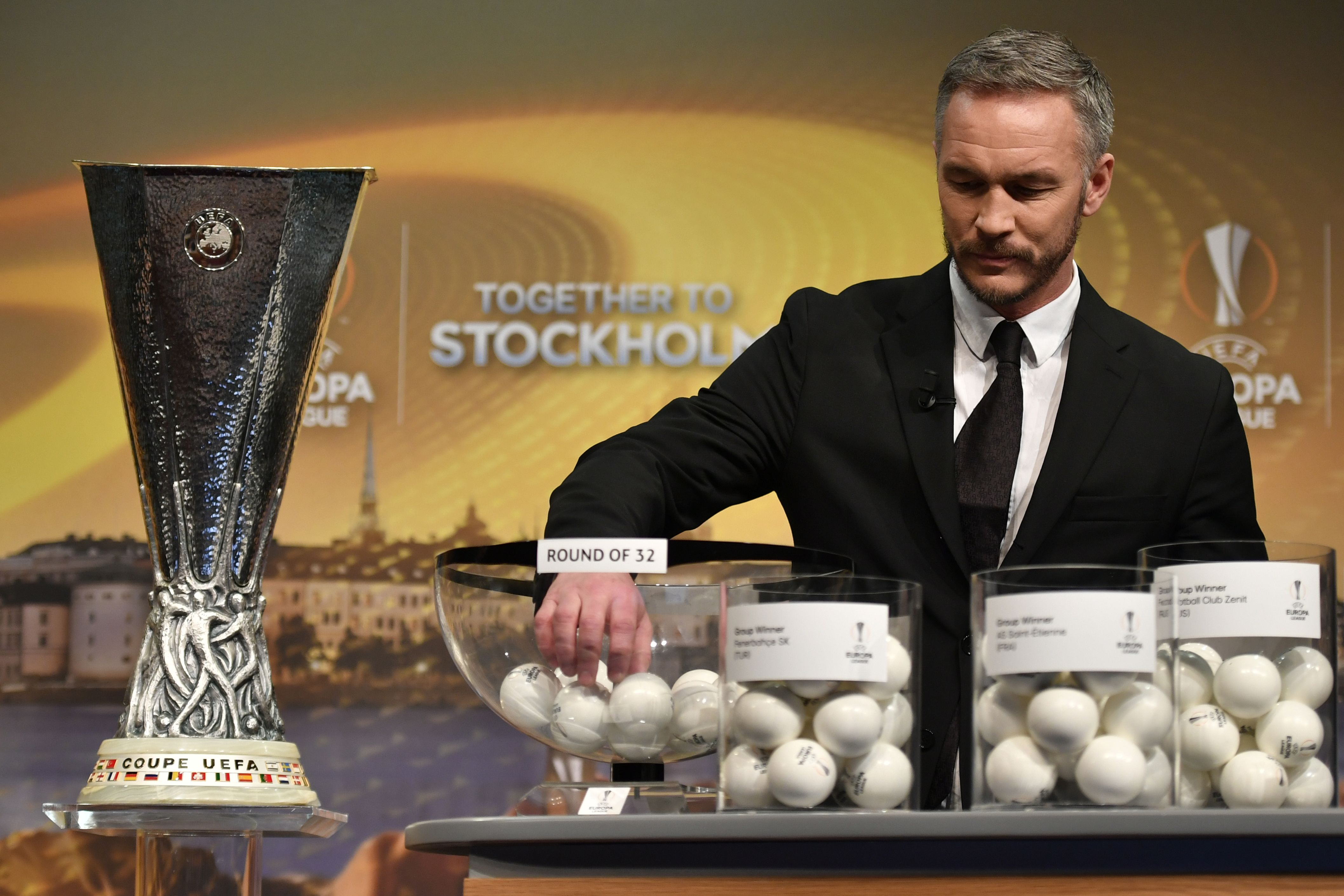 Sweden's former defender and 2017 Europa League final ambassador Patrik Andersson holds the draw for the round of 32 of the UEFA Europa League football tournament at the UEFA headquarters in Nyon on December 12, 2016. / AFP / Fabrice COFFRINI        (Photo credit should read FABRICE COFFRINI/AFP/Getty Images)