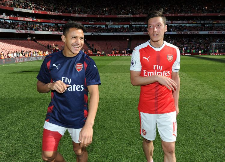 LONDON, ENGLAND - MAY 21: Mesut Ozil and Alexis Sanchez of Arsenal after the Premier League match between Arsenal and Everton at Emirates Stadium on May 21, 2017 in London, England. (Photo by David Price/Arsenal FC via Getty Images)