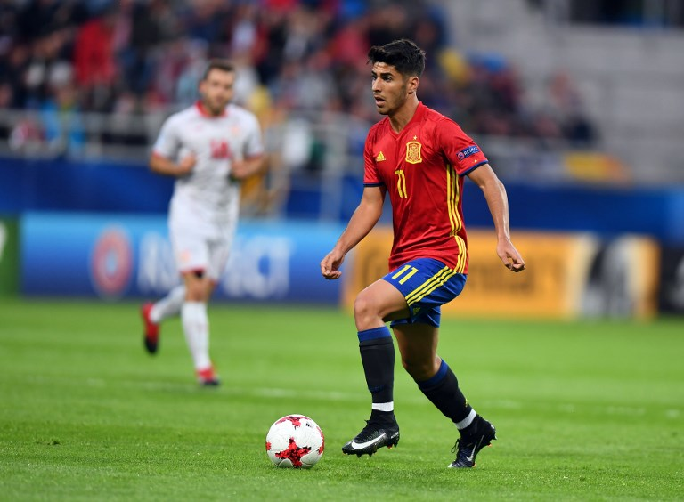 Spain's midfielder Marco Asensio scores during the UEFA U-21 European Championship Group B football match Spain v FYR Macedonia on June 17, 2017 in Gdynia, Poland. / AFP PHOTO / Maciej GILLERT