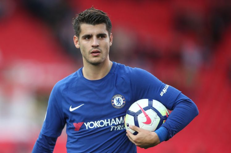 STOKE ON TRENT, ENGLAND - SEPTEMBER 23: Alvaro Morata of Chelsea celebrates with the match ball at full time during the Premier League match between Stoke City and Chelsea at Bet365 Stadium on September 23, 2017 in Stoke on Trent, England. (Photo by Robbie Jay Barratt - AMA/Getty Images)