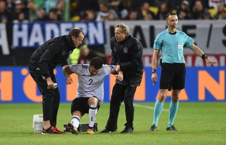 Medical staff help injured Germany's def