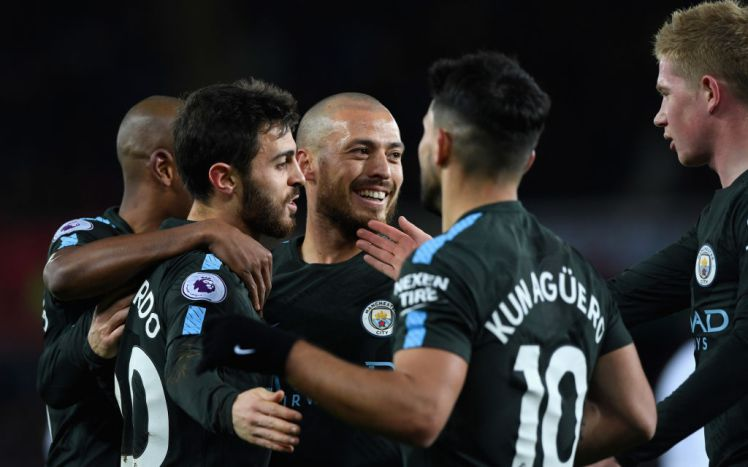 SWANSEA, WALES - DECEMBER 13:  Manchester City goalscorer David Silva (c) celebrates his opening goal with team mates during the Premier League match between Swansea City and Manchester City at Liberty Stadium on December 13, 2017 in Swansea, Wales.  (Photo by Stu Forster/Getty Images)